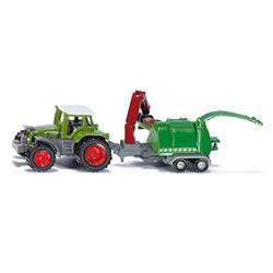 Tracteur avec broyeur à branches